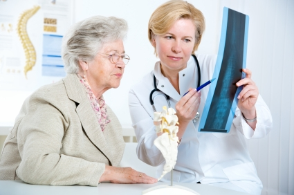 Elderly woman looking at her x-ray results with a doctor
